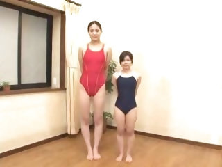 A long tall women and a short girl