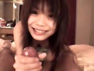 Tiny and tight Japanese girl sucking a guy off in a hotel room for a great facial before fucking him. You rarely get to see tits this perfect on an As